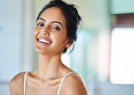 a lady smiling with white teeth